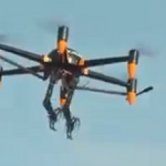 PICTURE OF DRONE WITH ROBOTIC ARMS