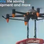 DRONE HOLDING LIFESAVING EQUIPMENT